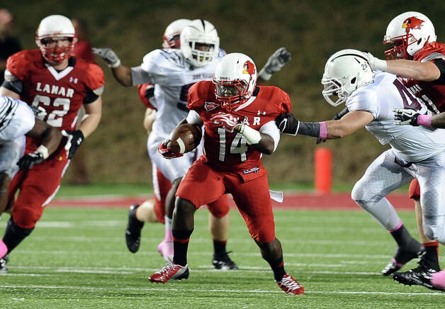 Lamar running back DePauldrick Garrett charges down the field for a first down during Lamar University football game against McMurry University at Provost Umphrey Stadium on Saturday, October 13, 2012. Photo taken: Randy Edwards/The Enterprise
