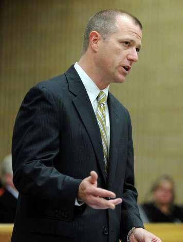 StateâÄôs Attorney Kevin Lawlor gives his argument during the sentencing hearing for former Oxford Tax Collector Karen Guillet Wednesday, Nov. 7, 2012 in state Superior Court in Milford, Conn.  Guillet, 63, pleaded guilty in July to a felony larceny charge for embezzling hundreds of thousands of dollars from the town while serving as tax collector. Photo: Autumn Driscoll / Connecticut Post