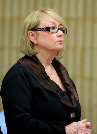 Former Oxford Tax Collector Karen Guillet is sentenced to four years in prison Wednesday, Nov. 7, 2012 in state Superior Court in Milford, Conn.  Guillet, 63, pleaded guilty in July to a felony larceny charge for embezzling hundreds of thousands of dollars from the town while serving as tax collector. Photo: Autumn Driscoll / Connecticut Post