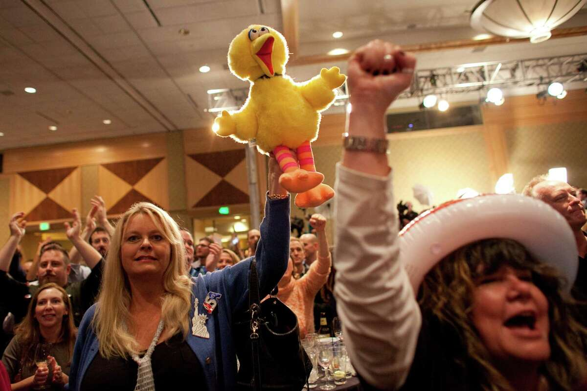 People celebrate as Barack Obama is announced as the likely winner on Election Day, Tuesday, November 6, 2012 during a Washington State Democratic Party event at the Westin in Seattle.