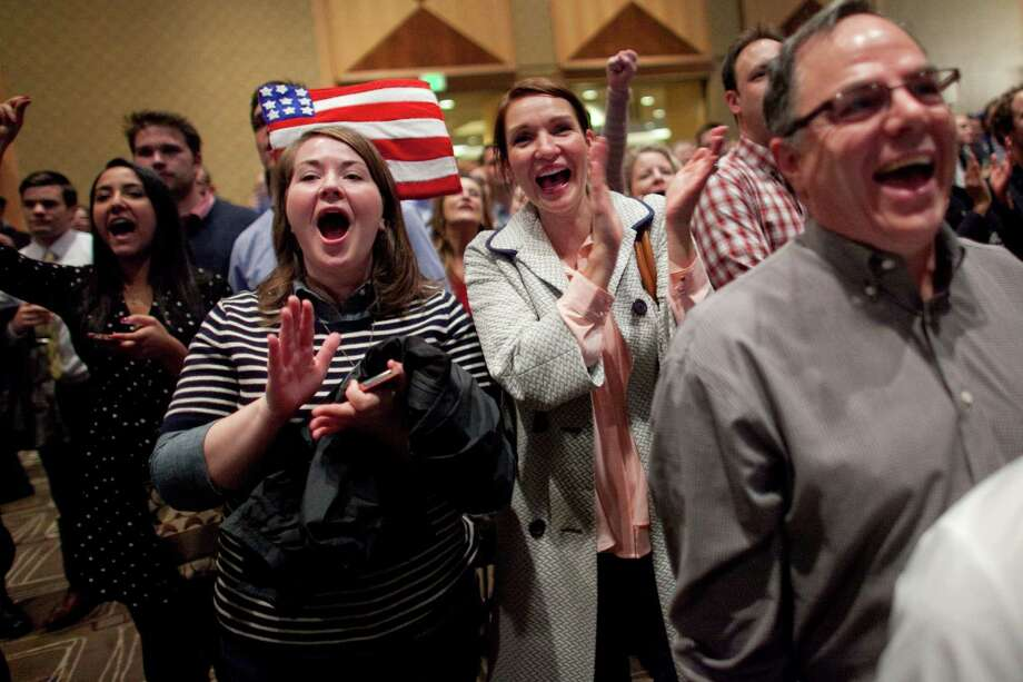 People celebrate as Barack Obama is announced as the likely winner on Election Day, Tuesday, November 6, 2012 during a Washington State Democratic Party event at the Westin in Seattle. Photo: JOSHUA TRUJILLO / SEATTLEPI.COM