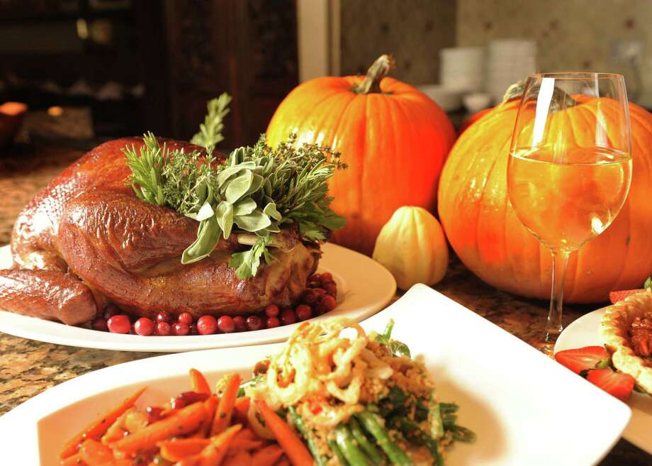 Thanksgiving dinner spread includes turkey and sides from Zocca Cuisine d'Italia at the Westin Riverwalk.