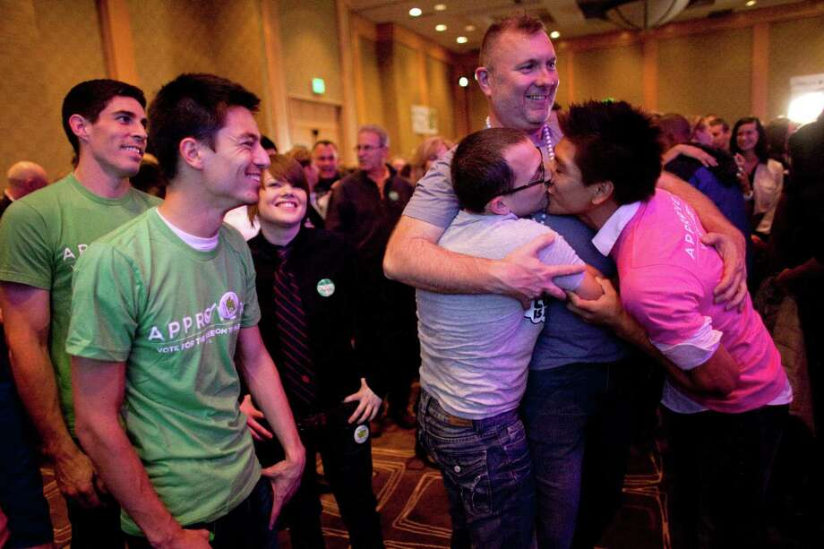 Brian Oberdan and Loui Love share a kiss as they watch returns on Referendum 74 during a party at the Westin Hotel on Election Day, Tuesday, November 6, 2012. Photo: JOSHUA TRUJILLO / SEATTLEPI.COM