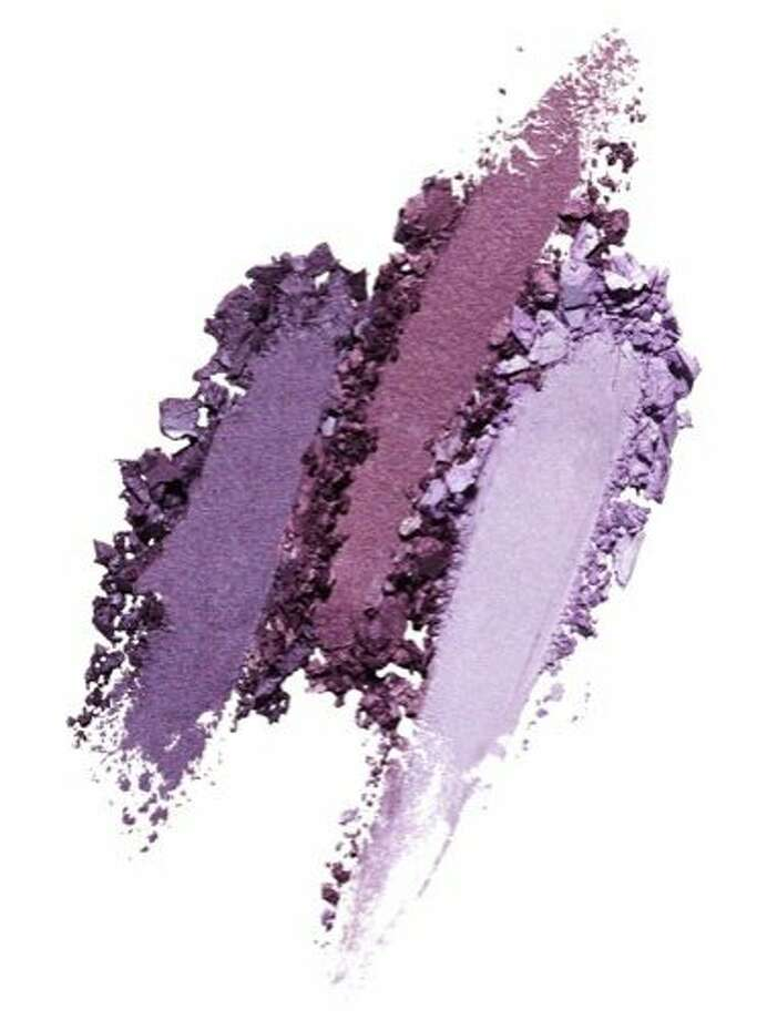 """The Look: Purple Eyeshadow """"Purple is the perfect color: It flatters every skin and eye color and never feels loud,"""" says Surratt.  He likes the mix of shades in the Shiseido Makeup Luminizing Satin Eye Color Trio in Bouquet, $33. """"No matter which one you use, ground the look with black mascara,"""" he adds. Photo: Greg Marino, Studio D"""