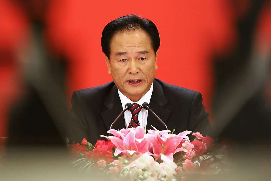 BEIJING, CHINA - NOVEMBER 07:  Cai Mingzhao,spokesman of the 18th CPC National Congress answers a question during a news conference at The Great Hall Of The People on November 7, 2012 in Beijing, China. The18th National Congress of the Communist Party of China (CPC) is proposed to convene on November 8 in Beijing.  (Photo by Lintao Zhang/Getty Images) Photo: Lintao Zhang, Getty Images