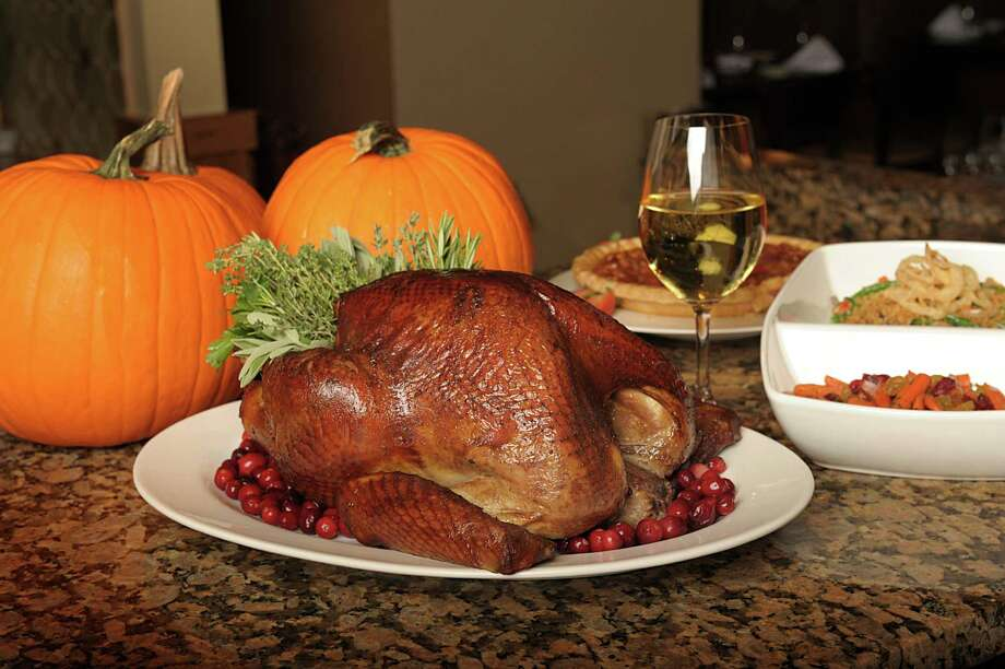 Want to keep your kitchen clean on Thanksgiving? Area restaurants have to-go options for everything you need for Thanksgiving, including turkey and ham, sides, pies, cakes and rolls. Simply call ahead and place orders. The website at the end of an entry directs you to more information. (Photo by Greg Harrison at Zocca Cuisine d'Italia at the Westin Hotel)-- Words by Jennifer Rodriguez/Special for the Express-News