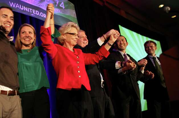 Governor Chris Gregoire celebrates the apparent passage of Referendum 74 with her family and State Senator Ed Murray, center, during a party at the Westin Hotel on Election Day, Tuesday, November 6, 2012. Photo: JOSHUA TRUJILLO / SEATTLEPI.COM