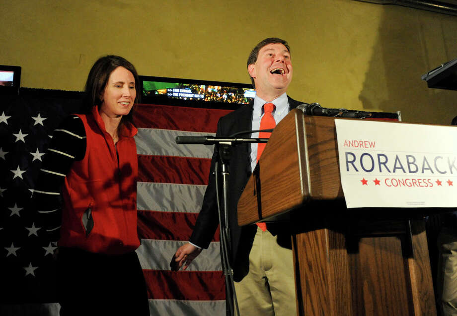 Andrew Roraback, with his wife, Kara Dowling, jokes during his concession speech at the Backstage Cafe in Torrington Tuesday night, Nov. 6, 2012. Roraback lost the race for the 5th District Congressional seat to Elizabeth Esty. Photo: Carol Kaliff / The News-Times