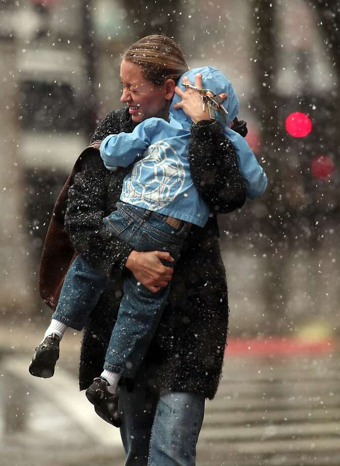 .Michelle Miller, of Morristown, N.J., braces against the wind and snow as she and her 3-year-old son Mahlon walk down South Street in Morristown, Wednesday, Nov. 7, 2012, as the northeast prepares for a nor'easter. The storm is expected to bring rain, sleet, snow and 50 mph wind gusts to Morris County, where 51,000 customers were still without power on Tuesday. Photo: Bob Karp, Associated Press