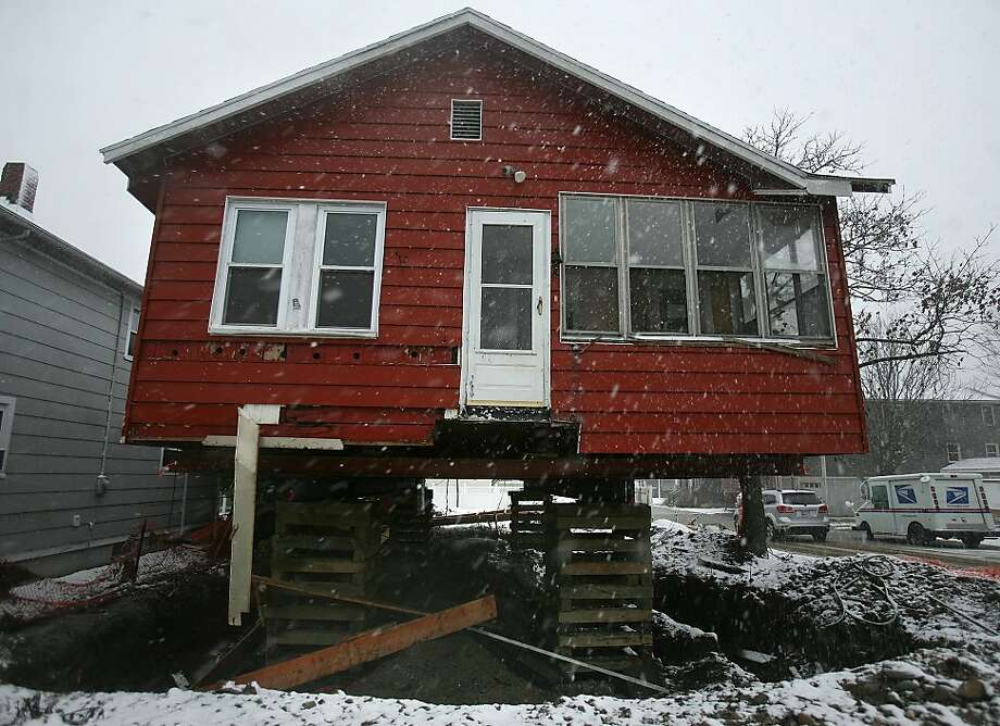 Snows from the nor'easter fall on a storm damaged home, in the process of being raised in the wake of Hurricane Sandy, in the Point Beach neighborhood in Milford on Wednesday, November 7, 2012. Photo: Brian A. Pounds