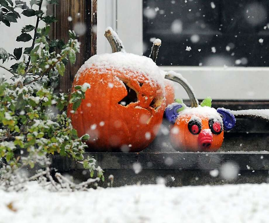 Two snow-covered Jack-o-lanterns on the front steps of a Terrace Avenue home in Riverside during the nor'easter that hit town, Wednesday, November 7, 2012. Photo: Bob Luckey, Connecticut Post