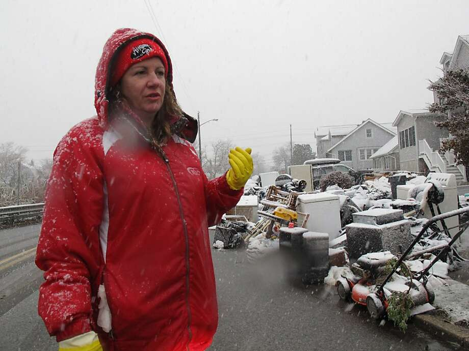 Laura DiPasquale talks about spending a third straight day looking through trash bags holding the contents of her storm-ruined house in Point Pleasant Beach, N.J., Wednesday Nov. 7, 2012. Complicating her task was snow from a nor'easter that was covering the bags and making them even wetter and heavier. Photo: Wayne Parry, Associated Press