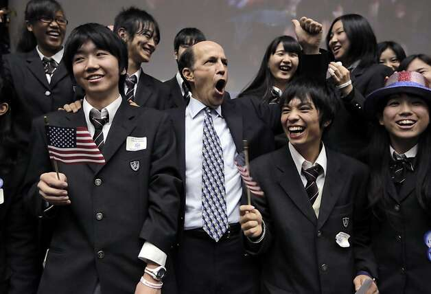 U.S. Ambassador to Japan John Roos, center, and Japanese high-school students celebrate reports that President Barack Obama won the presidential election at the U.S. Embassy in Tokyo Wednesday, Nov. 7, 2012. (AP Photo/Itsuo Inouye) Photo: Itsuo Inouye, Associated Press