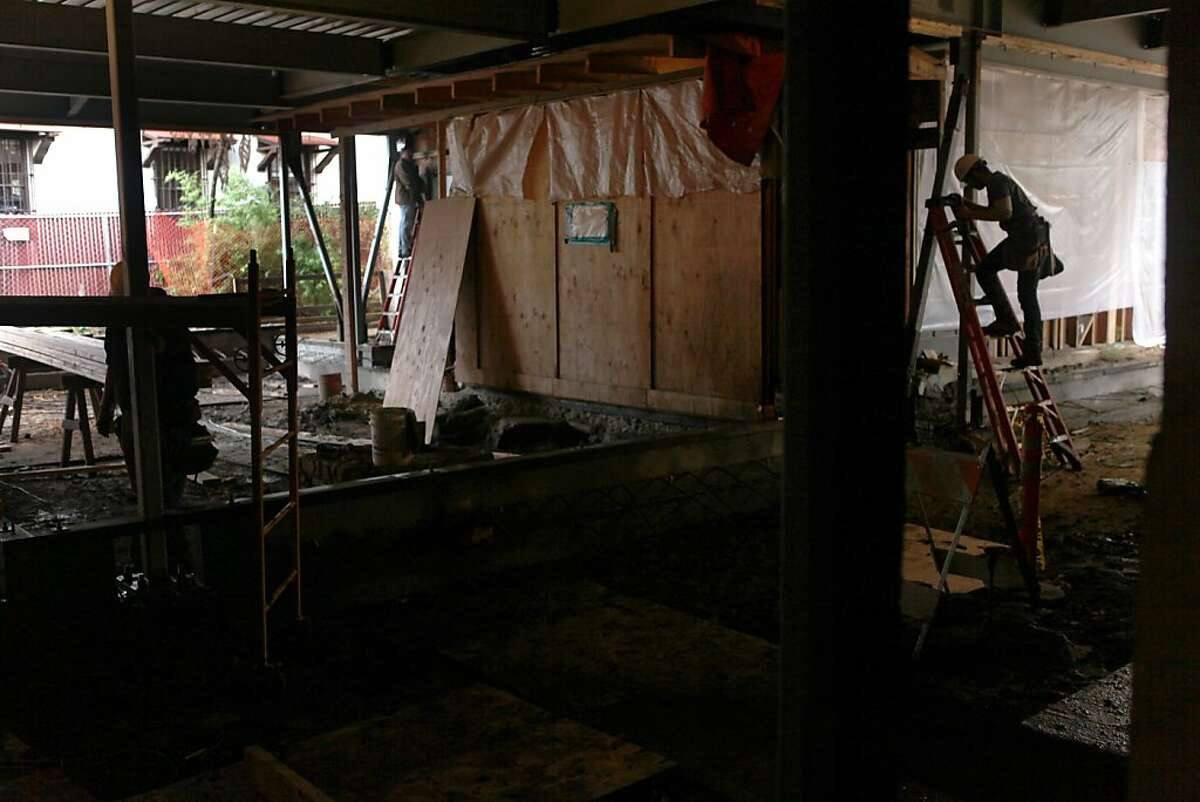 Construction at the Officers' Club, which is being transformed into a heritage gallery and exhibit hall, exposed the adobe walls of El Presidio de San Francisco, the Spanish fort built more than two centuries ago.