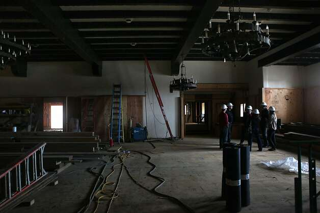 Workers huddle as construction work in Moraga Hall of the Presidio Officers' Club continues in late October. Photo: Liz Hafalia, The Chronicle