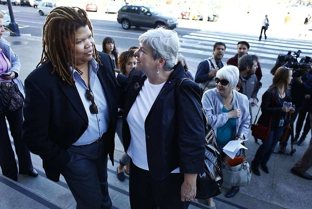 Andrea Shorter, commissioner City and County of San Francisco Commission on the Status of Women and Beverly Upton, executive director of the Domestic Violence Consortium, greet each other before a press conference held by the Domestic Violence Consortium and leaders in San Francisco's women's community at City Hall to call on Sheriff Ross Mirkarimi to resign on Thursday, January 12, 2012 in San Francisco, Calif.