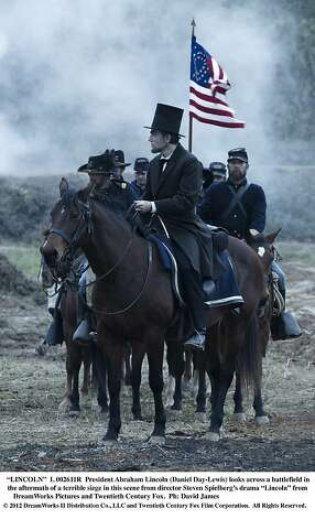 "President Abraham Lincoln (Daniel Day-Lewis) looks across a battlefield in the aftermath of a terrible siege in this scene from director Steven Spielberg's drama ""Lincoln."" Photo: David James, Touchstone Pictures"