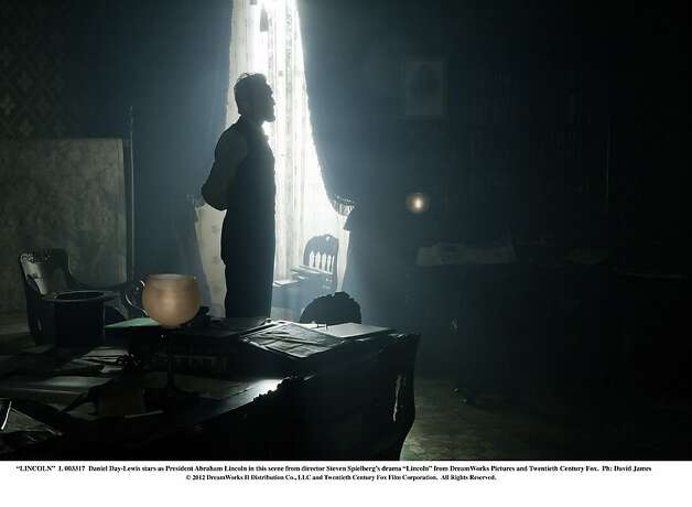 "Daniel Day-Lewis stars as President Abraham Lincoln in this scene from director Steven Spielberg's drama ""Lincoln.""  Photo: David James, Touchstone Pictures"
