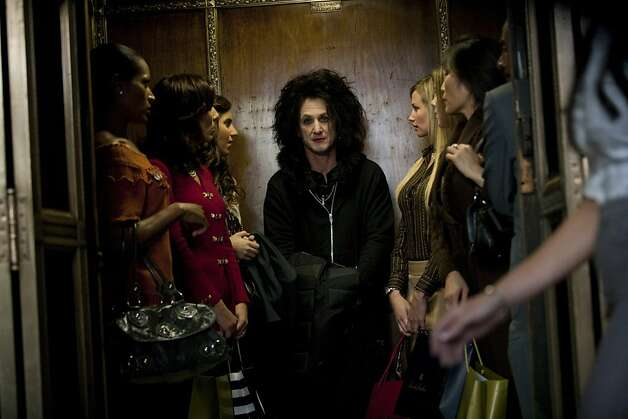 "Sean Penn (center) plays a former rock star from the 1980s who still wears bright red lipstick and dyed goth hair in ""This Must Be the Place."" Photo: Chuck Zlotnick, The Weinstein Co."