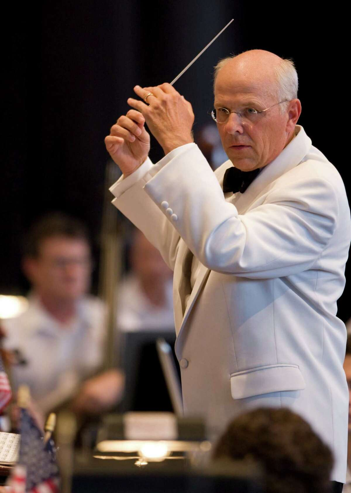 Michael Krajewski, principal pops conductor for the Houston Symphony, conducts the symphony during the annual Independence Day concert at the Cynthia Woods Mitchell Pavilion Thursday, July 3, 2008, in The Woodlands. ( Brett Coomer / Chronicle )