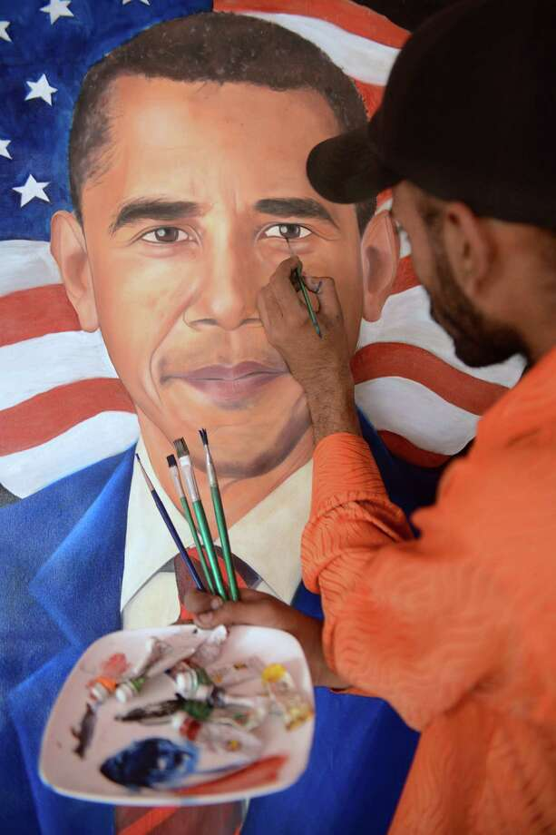 Indian painter Jagjot Singh Rubal gives final touches to a painting of re-elected US President Barack Obama, which he plans to mail to Obama as a gift, in Amritsar on November 7, 2012. US President Barack Obama swept to re-election Tuesday, making history by overcoming a slow economic recovery and the high unemployment which haunted his first term to beat Republican Mitt Romney. Photo: NARINDER NANU, AFP/Getty Images / AFP