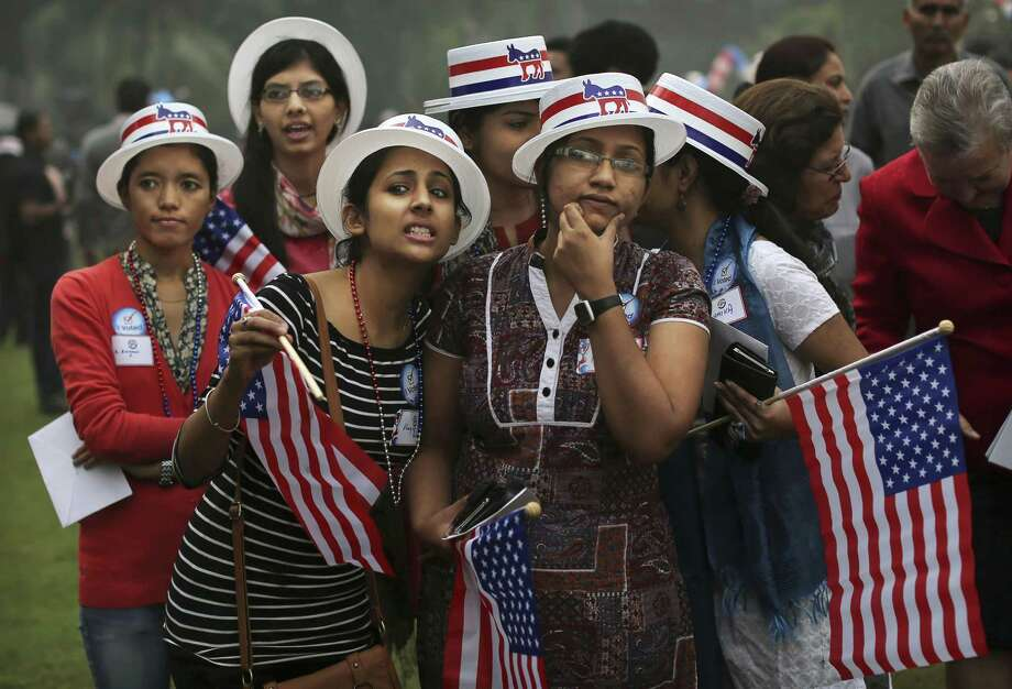 Indian students react to results on television networks during an event organized by the U.S. embassy at the landmark Imperial Hotel in New Delhi, India, Wednesday, Nov. 7, 2012. Obama captured a second White House term, blunting a mighty challenge by Republican Mitt Romney as Americans voted for a leader they knew over a wealthy businessman they did not. Photo: Kevin Frayer, Associated Press / AP