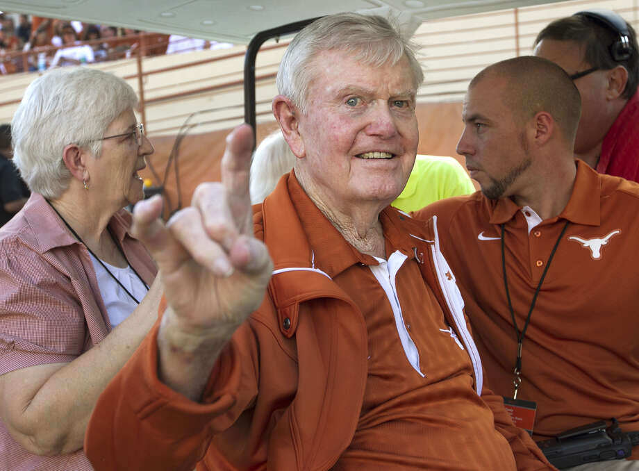 "Texas legendary head football coach Darrell K. Royal gives the ""Hook'em Horns"" hand gesture when he was honored Sept. 1 before the season-opening game against Wyoming in Austin. (AP Photo/Statesman.com, Ralph Barrera) Photo: Ralph Barrera, Associated Press / American-Statesman"