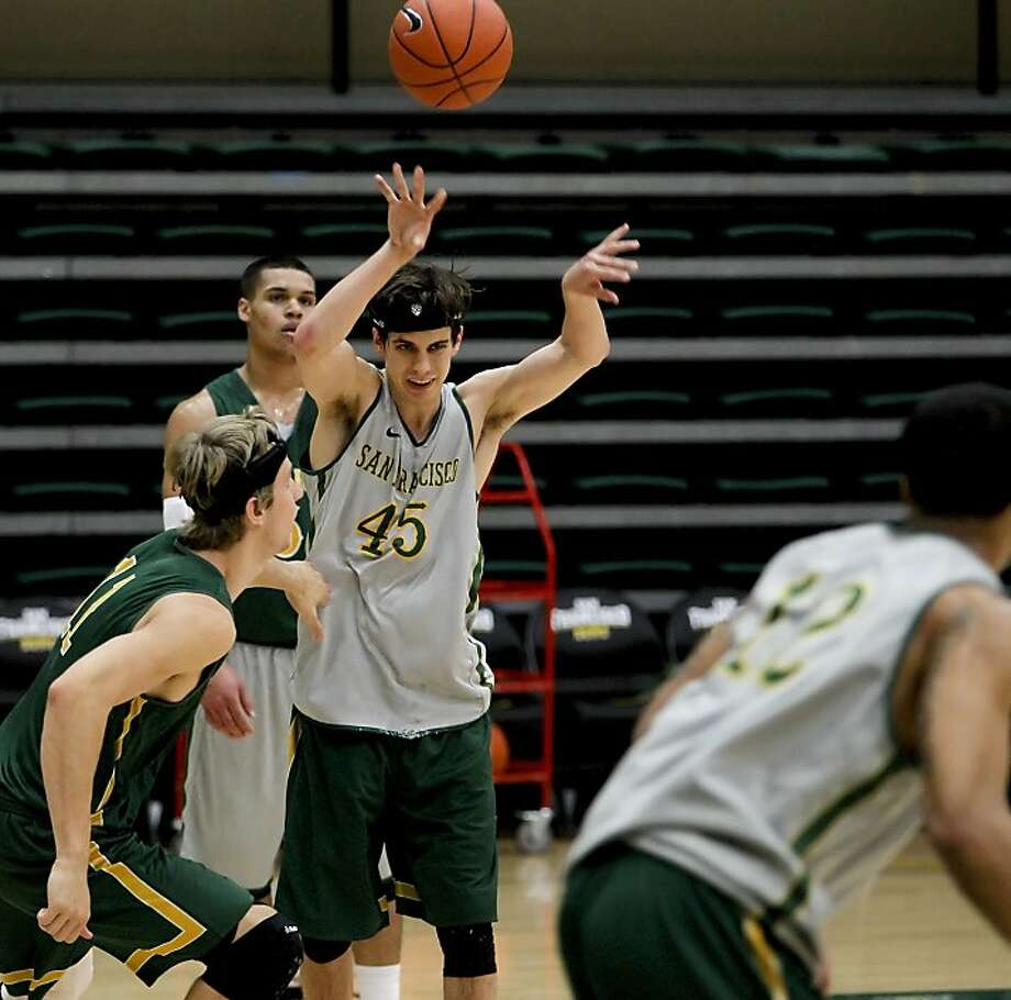 Junior guard Cody Doolin (center) is USF's only returning starter after six teammates transferred following last season. Photo: Michael Macor, The Chronicle