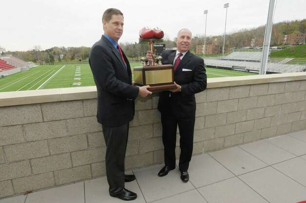 Bob Bodor, left, RPI head football coach, and John Audino, Union head football coach hold the Dutchman Shoes trophy as they pose for photographers at the East Campus Athletic Village at RPI on Wednesday, Nov. 7, 2012 in Troy, NY.  RPI and Union football will meet on Saturday for the 112th Dutchman Shoes football game.  (Paul Buckowski / Times Union) Photo: Paul Buckowski