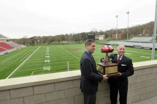 Bob Bodor, left, RPI head football coach, and John Audino, Union head football coach hold the Dutchman Shoes trophy as they pose for photographers at the East Campus Athletic Village at RPI on Wednesday, Nov. 7, 2012 in Troy, NY.  RPI and Union football will meet on Saturday for the 112th Dutchman Shoes football game.  (Paul Buckowski / Times Union) Photo: Paul Buckowski  / 00019960A
