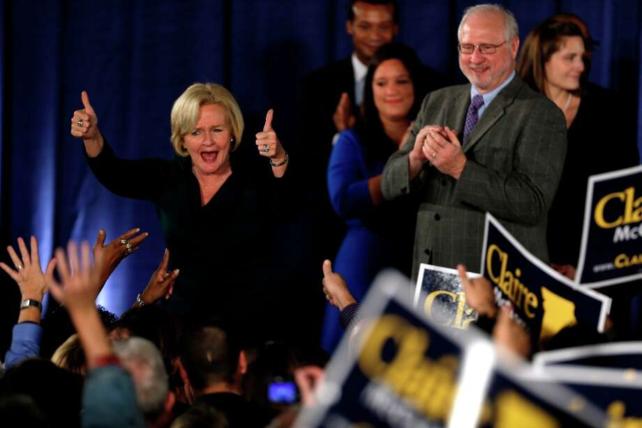 Sen. Claire McCaskill, D-Mo., celebrates after declaring victory over challenger Rep. Todd Akin, R-Mo., in the Missouri Senate race Tuesday, Nov. 6, 2012, in St. Louis. (AP Photo/Jeff Roberson) Photo: Jeff Roberson, Associated Press / AP