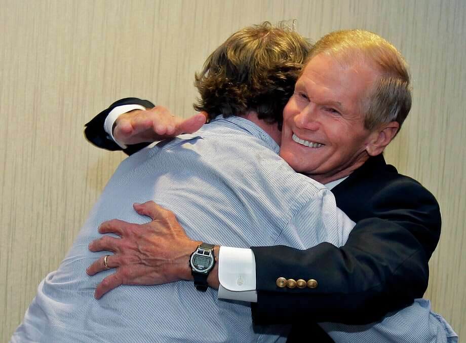 U.S. Sen. Bill Nelson, D-Fla., right, hugs a member of his campaign staff after he was declared the projected winner in his senate race, Tuesday, Nov. 6, 2012, in Orlando, Fla. (AP Photo/John Raoux) Photo: John Raoux, Associated Press / AP