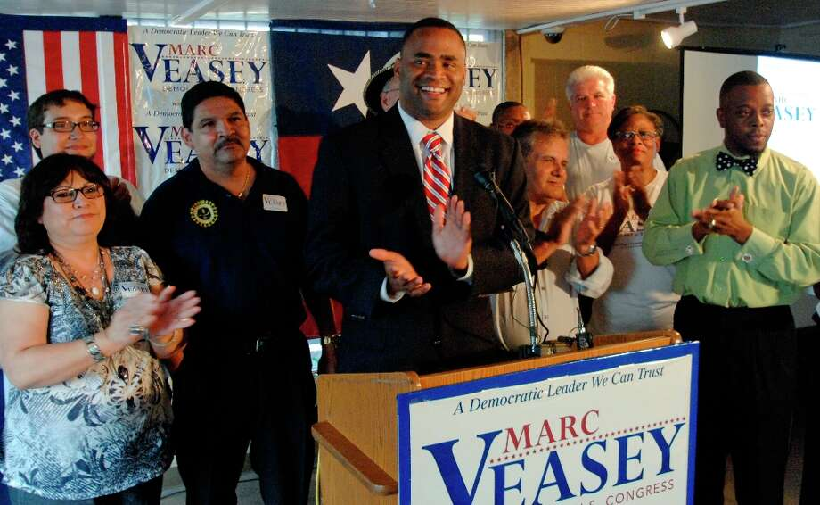 U.S. House of Representatives District 33 candidate, Marc Veasey, applauds his supporters during an election day celebration at Smokeys BBQ on Lancaster Avenue in East Fort Worth Tuesday, May 29, 2012 evening.  Robert W. Hart/Special Contributor Photo: ROBERT W. HART, Robert W. Hart/Photographer / ©2012 Robert W. Hart