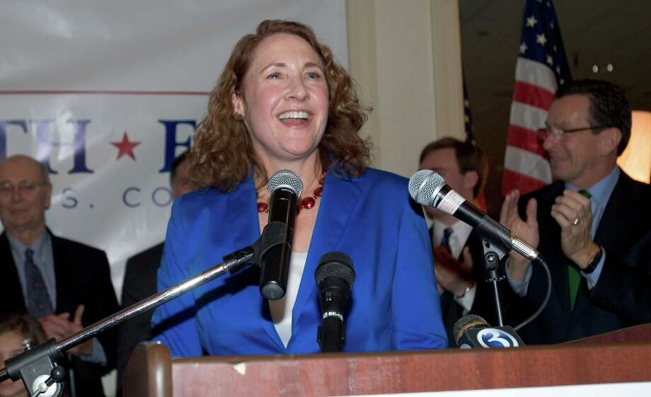 Democrat Elizabeth Esty gives her acceptance speech in Waterbury, Conn., Tuesday, Nov. 6, 2012 after she defeated challenger Republican Andrew Roraback for the 5th Congressional District seat Tuesday night in Connecticut. Applauding Esty's victory is Connecticut Gov. Dannel P. Malloy, right. (AP Photo/The Republican-American, Steve Valenti) Photo: Steve Valenti, Associated Press / The Republican-American