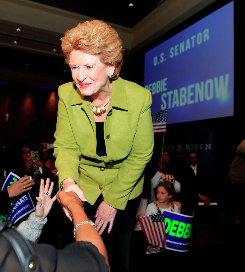 Sen. Debbie Stabenow, D-Mich., meets with guests after addressing supporters at the Michigan Democratic election night party at the MGM Grand Detroit, Tuesday, Nov. 6, 2012. Stabenow defeated Republican challenger Pete Hoekstra. (AP Photo/Carlos Osorio) Photo: Carlos Osorio, Associated Press / AP