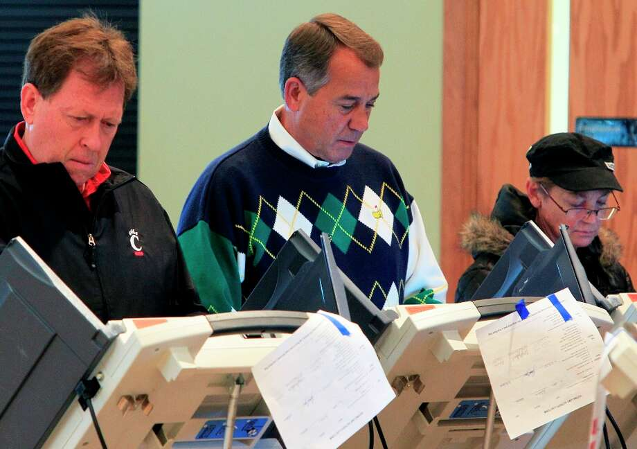 Speaker John Boehner, R-Ohio, center, votes at Ronald Reagan Lodge, Tuesday, Nov. 6, 2012, in West Chester, Ohio.  After a grinding presidential campaign, Americans head into polling places across the country.  (AP Photo/Al Behrman) Photo: Al Behrman, Associated Press / AP