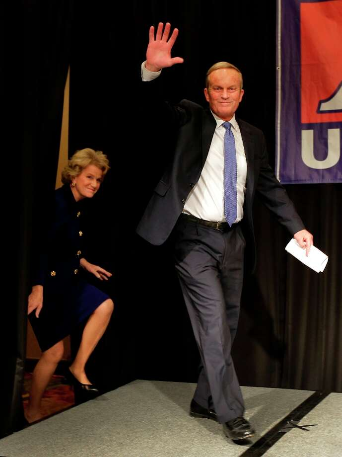 U.S. Senate candidate, Rep. Todd Akin, R-Mo., with his wife Lulli take the stage to make his concession speech to U.S. Sen. Claire McCaskill, D-Mo. Tuesday, Nov. 6, 2012, in Chesterfield, Mo. (AP Photo/Charlie Riedel) Photo: Charlie Riedel, Associated Press / AP