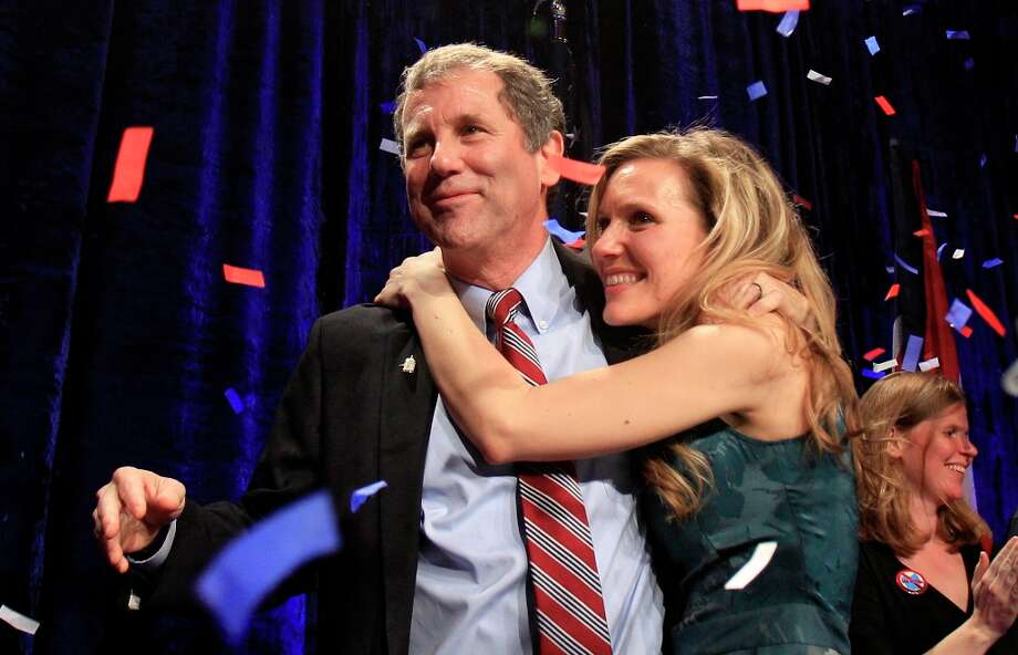 Democratic Sen. Sherrod Brown, left, is hugged by his daughter, Liz, as they celebrate at the Ohio Democratic party election night celebration  Tuesday, Nov. 6, 2012, in Columbus, Ohio. Brown defeated GOP challenger Josh Mandel, the state treasurer. (AP Photo/Tony Dejak) Photo: Tony Dejak, Associated Press / AP