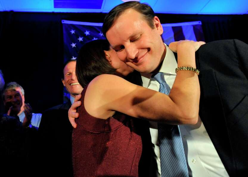 Newly elected Democratic Sen. Chris Murphy celebrates his win with wife Cathy Holahan Murphy over Re