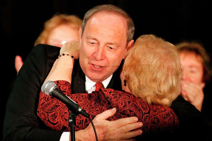 Tom Smith, Pennsylvania Republican candidate for the U.S. Senate hugs his wife Saundy after concedin