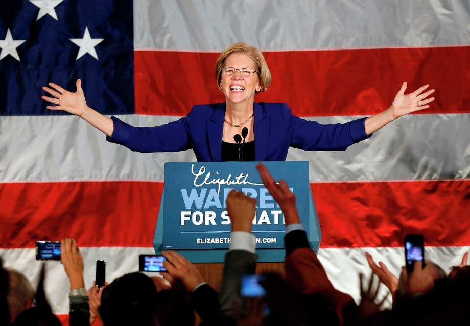 Democrat Elizabeth Warren takes the stage after defeating incumbent GOP Sen. Scott Brown in the Massachusetts Senate race, during an election night rally at the Fairmont Copley Plaza hotel in Boston, Tuesday, Nov. 6, 2012. (AP Photo/Michael Dwyer) Photo: Michael Dwyer, Associated Press / AP