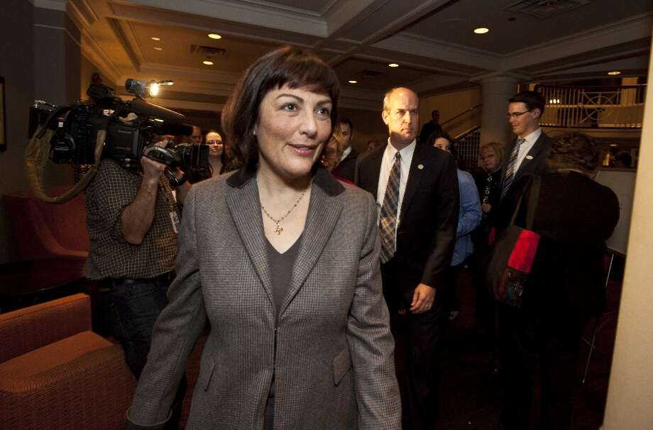 Suzan DelBene rushes through a room of supporters on her way to her room upstairs at a party at the Woodmark Hotel in Kirkland. DelBene, a Democrat,  is running for the U. S. House - District 1.  To DelBene's right is U.S. Rep. Rick Larsen. (AP Photo/The Seattle Times, Ellen M. Banner) Photo: Ellen Banner, Associated Press / The Seattle Times