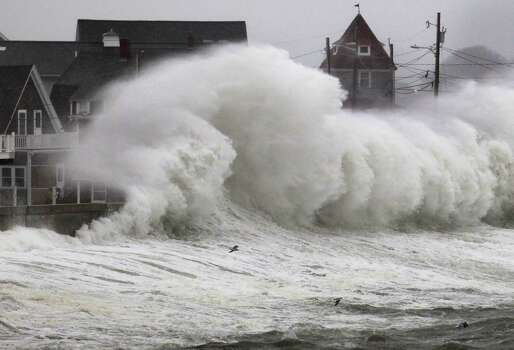Waves crash into a seawall and buildings along the coast in Hull, Mass., Wednesday, Nov. 7, 2012. A high-wind warning is in effect in the state until Wednesday night, with gusts of up to 60 mph expected in some costal areas, and 50 mph gusts expected for Boston and western Massachusetts. Photo: Steven Senne, Associated Press / AP