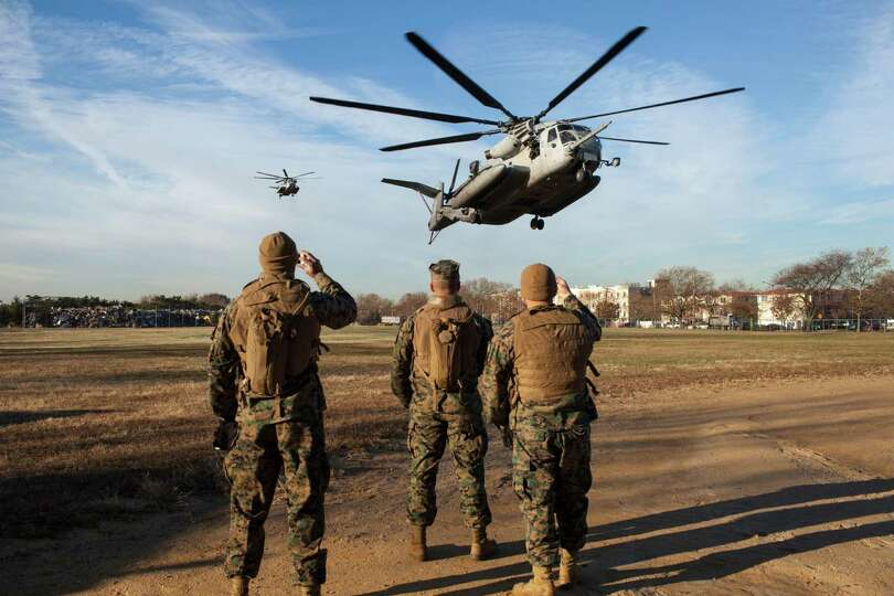 U.S. Marines from the 26th Marine Expeditionary Unit and U.S. Navy seamen from the U.S.S. Wasp land