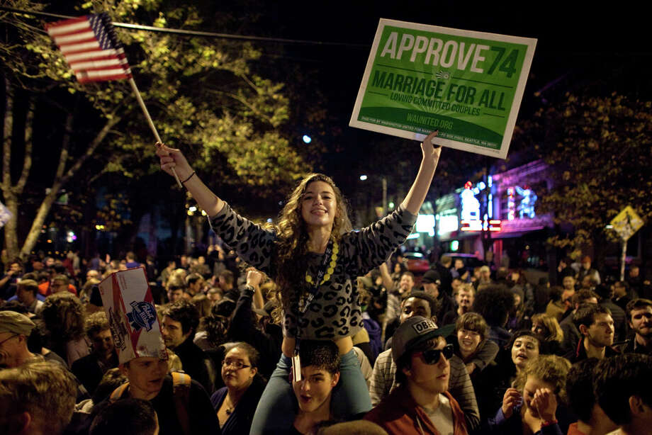 Seattle University student Victoria Czorny rides on the shoulders of a friend as a spontaneous party erupts in the intersection of East Pike Street and 10th Avenue after Barack Obama was announced as the winner, Referendum 74 appeared to be passing and a measure to legalize marijuana also seemed to be passing on Election Day, Tuesday, November 6, 2012. Photo: JOSHUA TRUJILLO / SEATTLEPI.COM