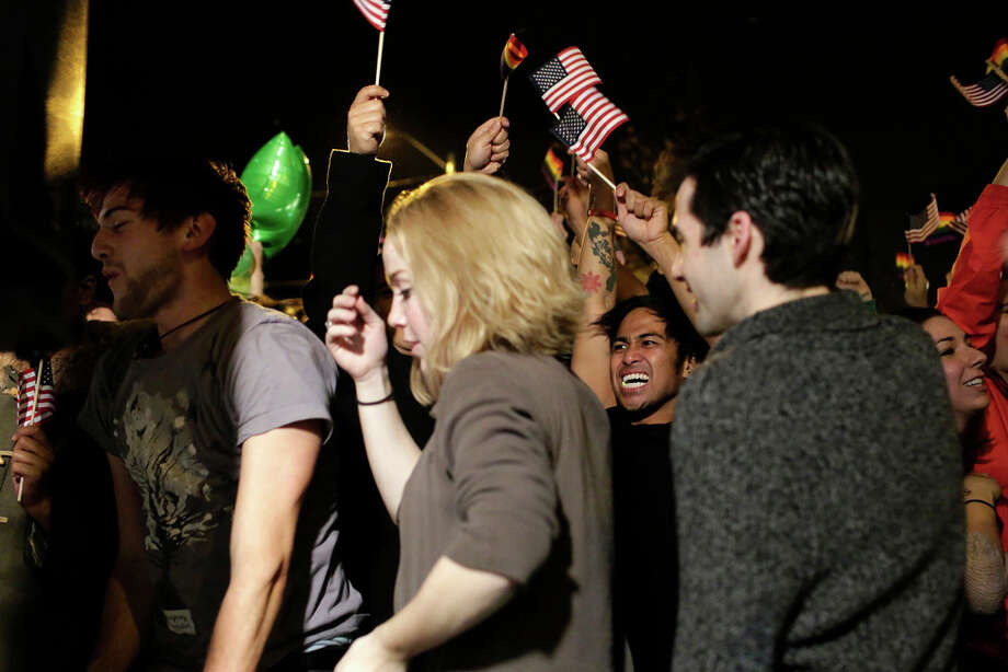 Crowds took to the streets to celebrate a second term reelection for President Barack Obama on election night Tuesday, November 6, 2012, on Capitol Hill in Seattle, Wash. Beforehand, crowds had flocked to return parties hosted by a number of bars in the area to wait out final ballot results. In addition to President Barack Obama's reelection, Referendum 74 and I-502 were both passed in Washington state. Photo: JORDAN STEAD / THE EMERALD COLLECTIVE / FOR SEATTLEPI.COM