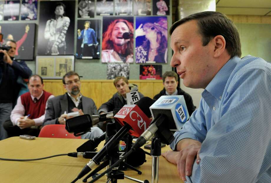 Democratic Sen.-elect Chris Murphy holds his first news conference at a hot dog restaurant he traditionally eats at after elections in New Britain, Conn., Wednesday, Nov. 7, 2012. Murphy beat Republican Linda McMahon, a former wrestling executive, in Tuesday's election. (AP Photo/Jessica Hill) Photo: Jessica Hill, Associated Press / FR125654 AP