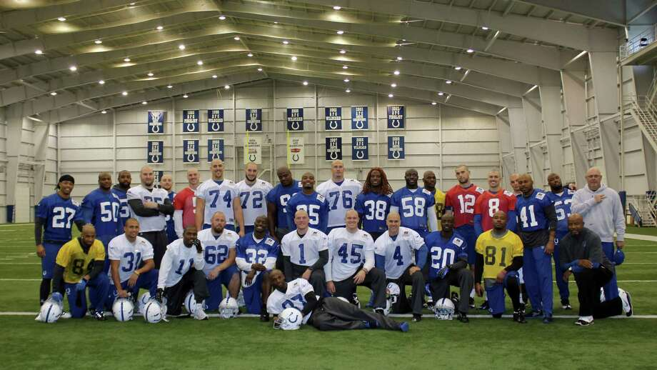 In this photo provided by the Indianapolis Colts, member of the Colts NFL team pose together in Indianapolis, Wednesday, Nov. 7, 2012. The Colts are going to great lengths to support their ailing coach Chuck Pagano. In a show of support, many players shaved their heads after Tuesday's practice. Pagano lost his hair while undergoing treatment for leukemia. (AP Photo/Indianapolis Colts) Photo: Indianapolis Colts