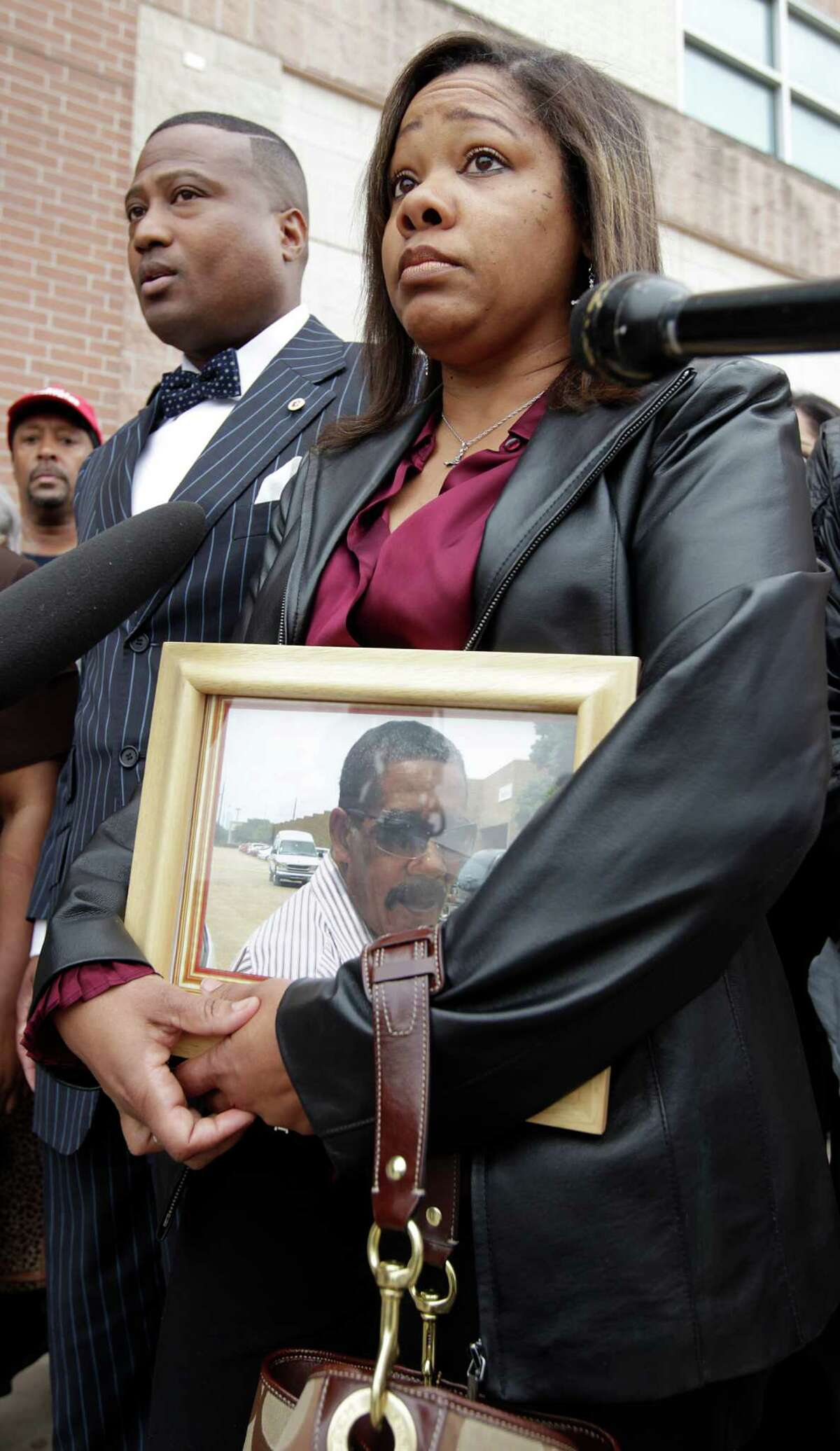 Evangeline Hicks Campbell holds a photo of her father Norman Ford Hicks, 72, during Quanell X's press conference in front of the Harris County Sheriff's jail at 1200 Baker Street, Monday, Jan. 31, 2011, in Houston, as he speaks to the media about Norman Ford Hicks, 72, who died from after an altercation, January 16, 2011, while in jail at the Baker Street location. The family is asking for information on the circumstances surrounding the altercation. ( Karen Warren / Houston Chronicle )