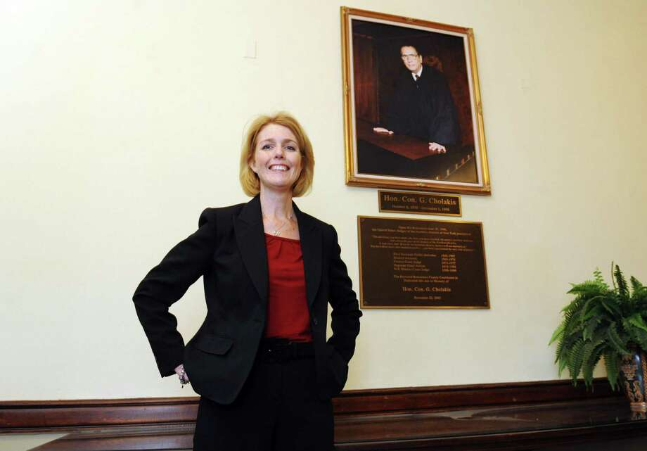 Debra Young was elected Rensselaer County Court Judge on Tuesday she is the first Republican elected as a Rensselaer County judge since Con G. Cholakis, in portrait on wall, who served from 1974-77 in Troy, NY Wednesday Nov. 7, 2012. (Michael P. Farrell/Times Union) Photo: Michael P. Farrell